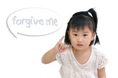 Asian child holding up her little finger Royalty Free Stock Images