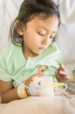 Asian Child Hospital Patient Feeling Depressed with Infusion Stock Photo