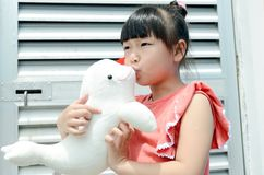 Asian child kiss the Dolphin Stock Photography