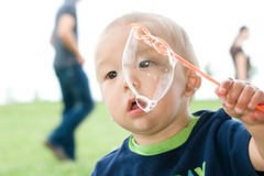 Asian Child with Large Bubbles Royalty Free Stock Images