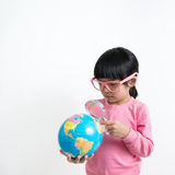 Asian child. Little Asian girl looking at the earth globe with magnifying glass Royalty Free Stock Image