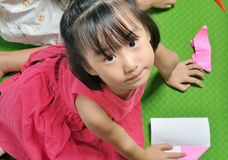 Asian child makes origami paper craft Stock Photography