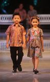 Asian child model at fashion show runway. Asian child model wearing indonesian traditional batik at batik keris fashion show held in Solo, Central Java Stock Image
