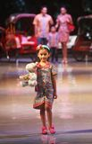 Asian child model at fashion show runway Stock Photography