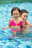 Asian child and mother fun in swimming pool Royalty Free Stock Image