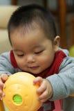 Asian child playing Stock Image