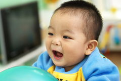 Asian child playing Stock Images