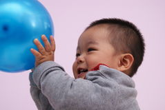 Asian child playing Royalty Free Stock Images