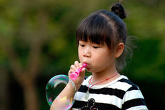 Asian child playing Blowing bubbles Stock Images