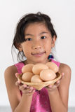 Asian child playing a chef at home. Childhood dream concept Royalty Free Stock Photos