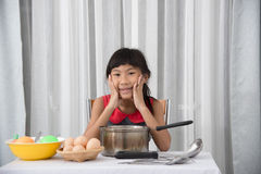 Asian child playing a chef at home. Royalty Free Stock Photo