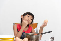 Asian child playing a chef at home. Stock Images