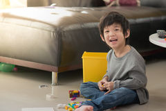 Asian child playing with colorful construction blocks Stock Image