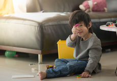 Asian child playing with colorful construction blocks Stock Photos