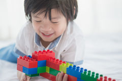 Asian child playing with colorful construction blocks Stock Photography