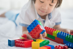 Asian child playing with colorful construction blocks Royalty Free Stock Image