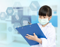 Asian child playing doctor Stock Photos