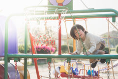 Asian child playing on playground in summer outdoor park Stock Photo