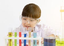 Asian child playing scientist with colorful lab tubes. Happy and cheerful Royalty Free Stock Image