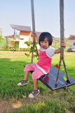 Asian child playing swing in the green mountain Royalty Free Stock Photos