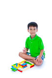 Asian child playing toy wood blocks, isolated on white background. stock photography