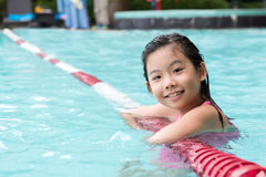 Asian child in the pool stock photography