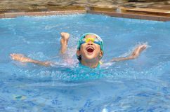 Asian child practice swimming. In the pool Royalty Free Stock Photography