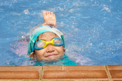 Asian child practice swimming Stock Images