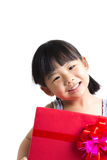Asian child with red gift box. Portrait of Asian child girl with red gift box represents Christmas theme Royalty Free Stock Photos