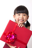 Asian child with red gift box. Happy Asian child girl with red gift box for Christmas theme Royalty Free Stock Photos