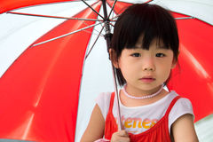 Asian child with red umbrella Royalty Free Stock Images