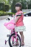 Asian child Riding a bicycle Royalty Free Stock Photos
