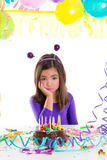 Asian child sad bored kid girl in birthday party. Asian child kid girl in birthday party bored sad gesture and chocolate cake Royalty Free Stock Photography