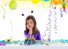 Asian child sad bored kid girl in birthday party. Asian child kid girl in birthday party bored sad gesture and chocolate cake Royalty Free Stock Photos