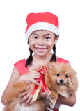 Asian Child in Santa hat with dog Royalty Free Stock Photography