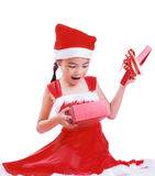 Asian Child in Santa hat with gift box Royalty Free Stock Photos