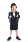 Asian child in school uniform with blue school bag Royalty Free Stock Images