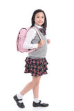 Asian child in school uniform with pink school bag on. White background isolated royalty free stock images