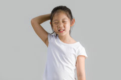 Asian Child Scratching Head and Smiling with White T-Shirt, Isolated on White, Studio Shot Stock Photos