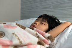 Asian child sleeping Royalty Free Stock Photos