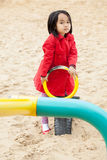 Asian child spending time on the playground Royalty Free Stock Photography