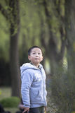 Asian child standing in park Royalty Free Stock Photography