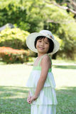Asian child with summer hat Royalty Free Stock Photography
