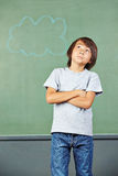 Asian child thinking in school Royalty Free Stock Images