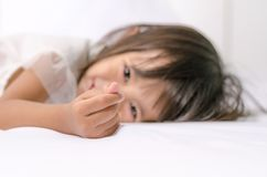 Asian child toddler girl making mini heart sign by her hand stock photo
