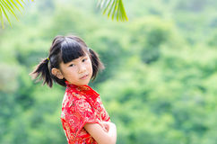 Asian child in traditional Chinese cheongsam with nature background Stock Photo