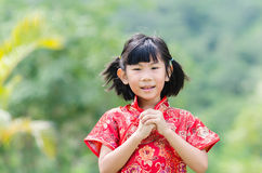 Asian child in traditional Chinese cheongsam Stock Image