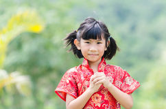 Asian child in traditional Chinese cheongsam Royalty Free Stock Photography