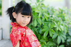 Asian child in traditional Chinese cheongsam Stock Photo