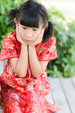 Asian child in traditional Chinese cheongsam Stock Photos